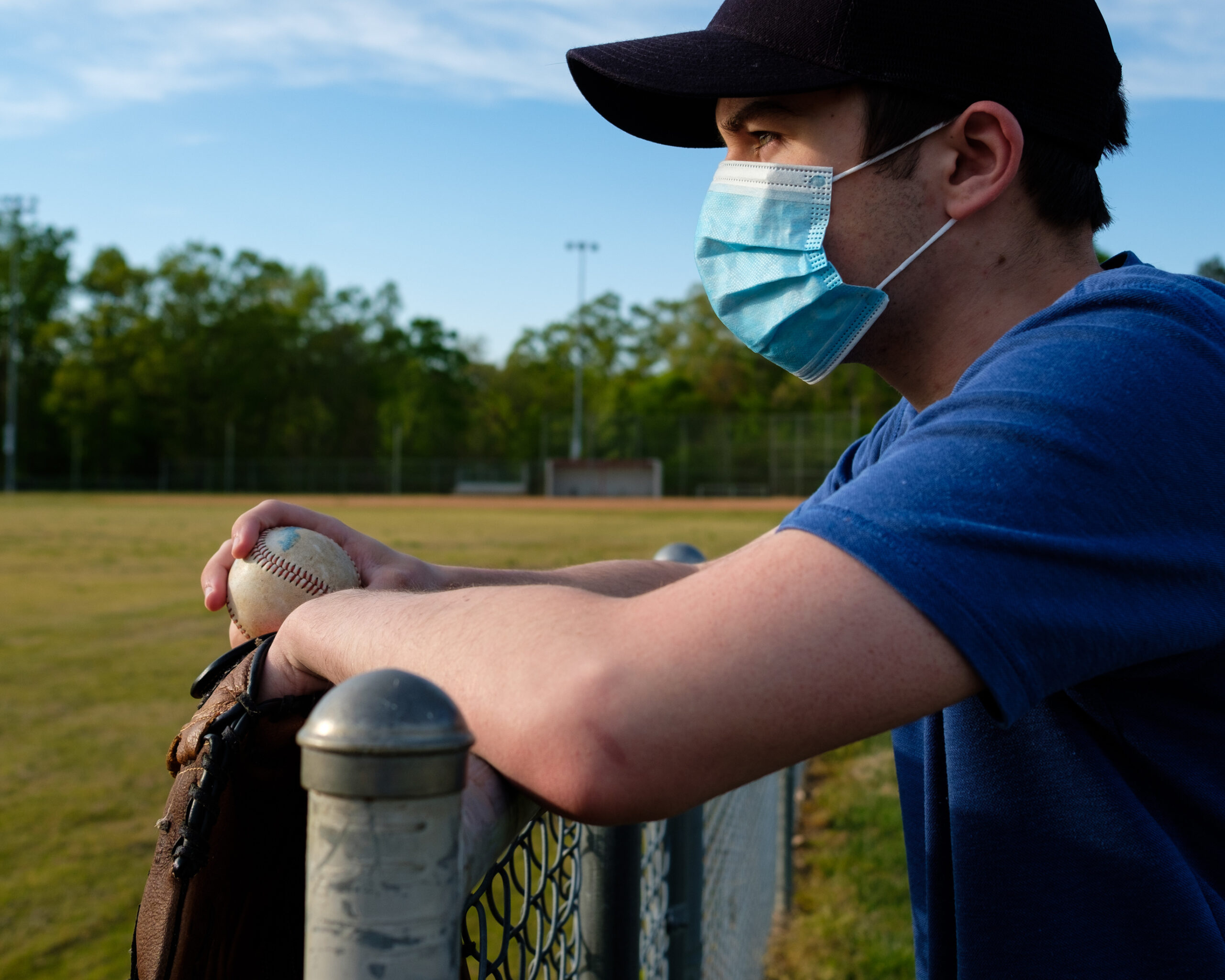 Waiting with Face Mask to Play Baseball