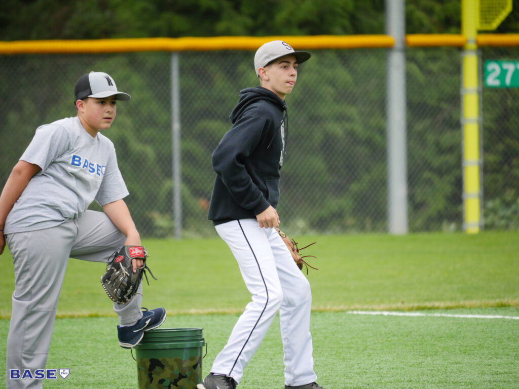 Two boys fielding grounders at summer camp