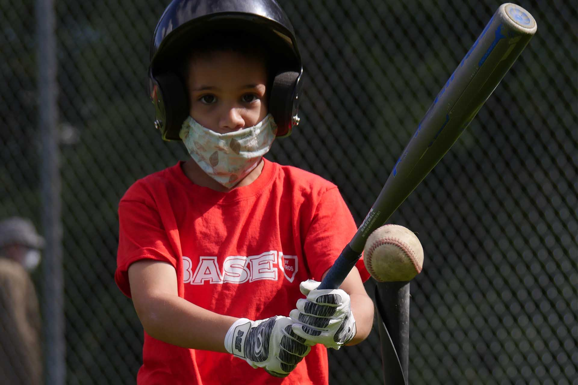 Boy Preparing to Hit at Batting Tee