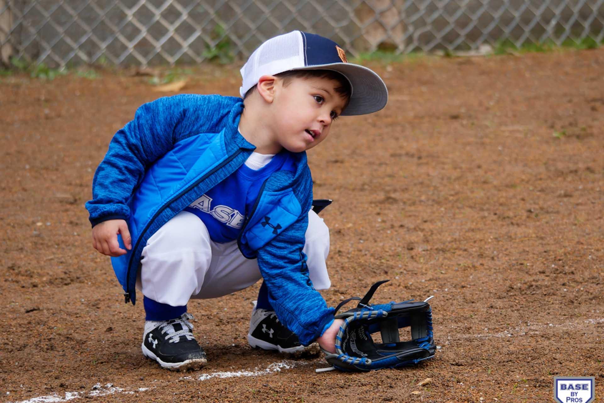 Little Boy Prepares to Field a Baseball