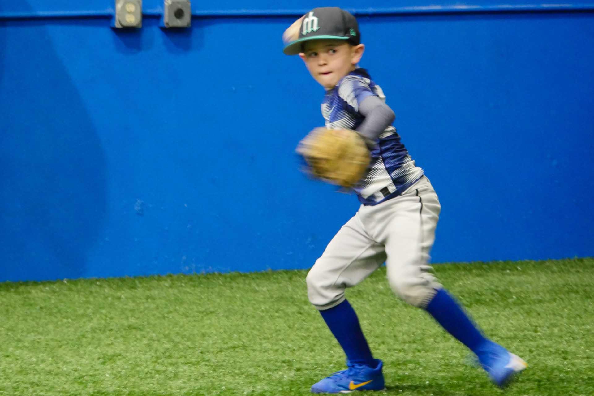 Little Boy Throwing a Baseball