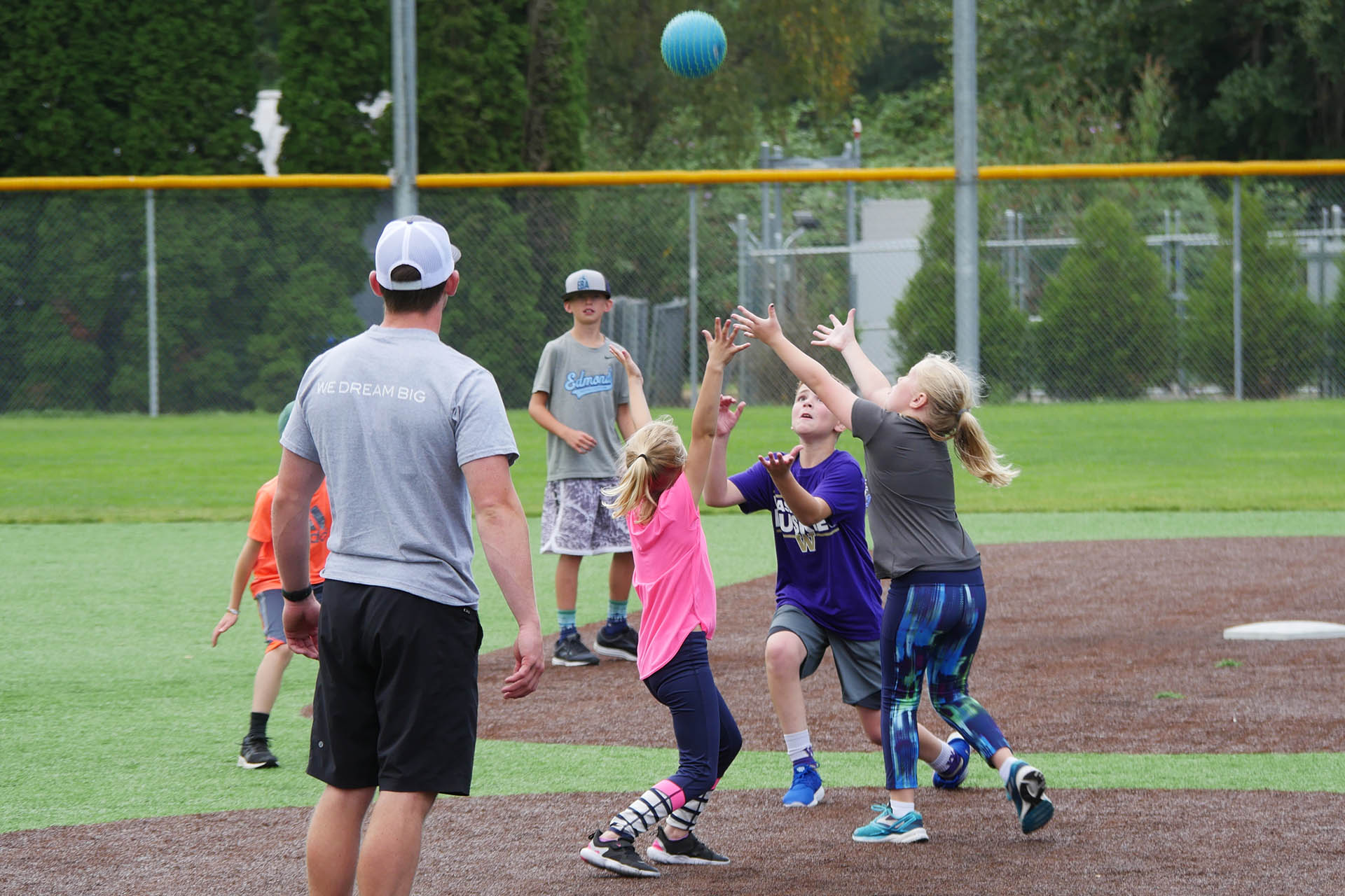 Kids competing at camp to catch a kickball