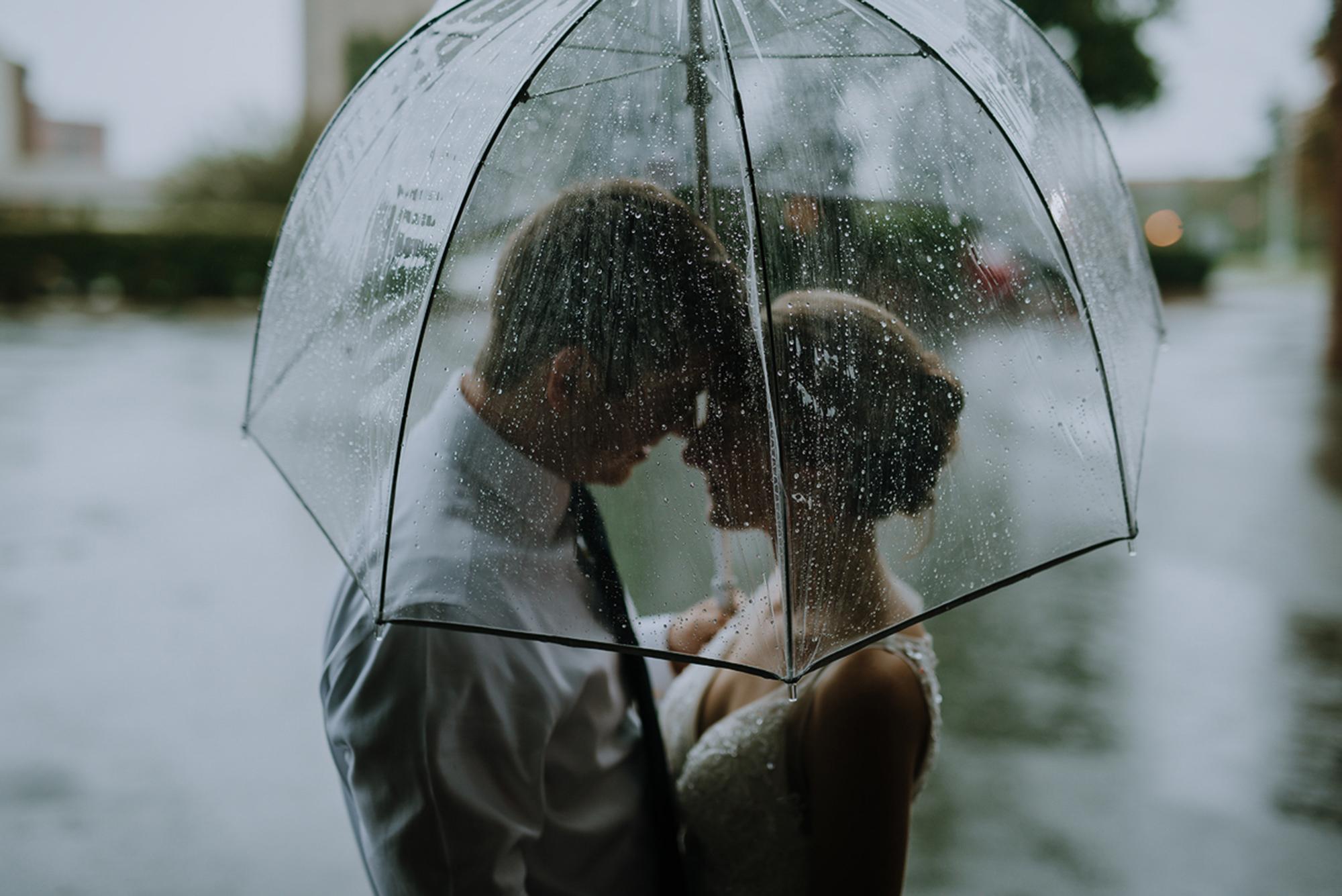 Rainey Wedding Day with Bride and Groom under umbrella