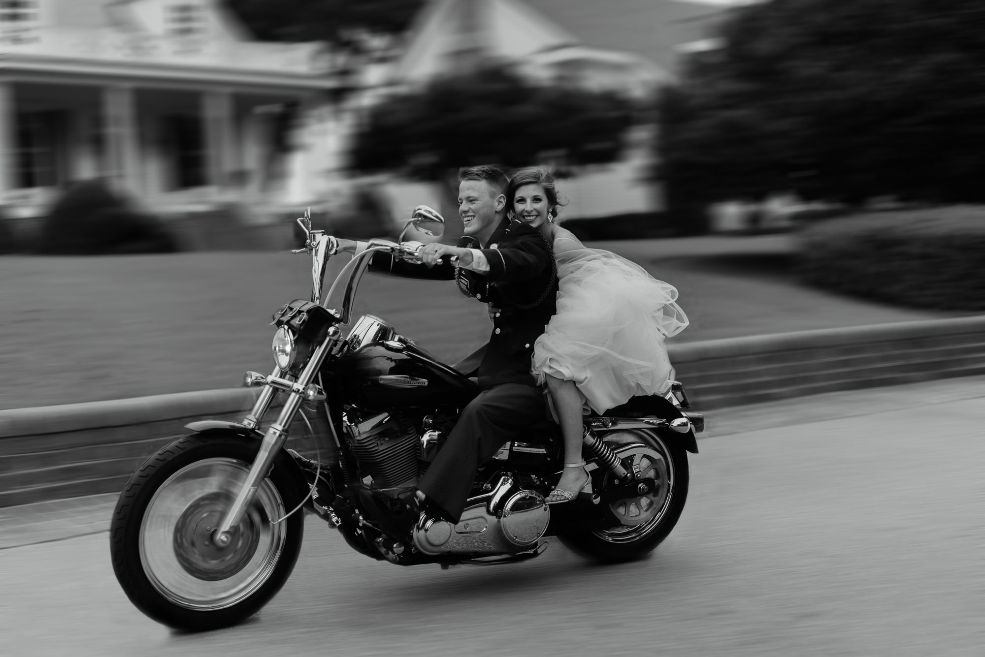 Bride and Groom riding off on motorcycle