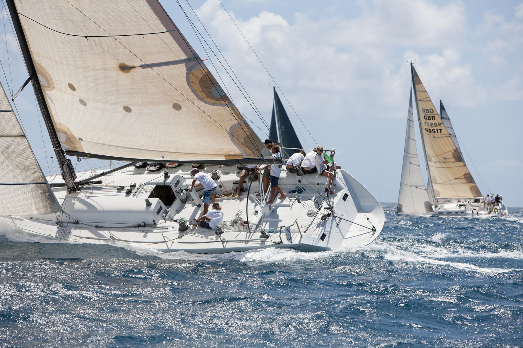 "Caribbean Sea between St. Thomas and St. John, US Virgin Islands - March 30, 2014: sailing crew on a sailboat ""Falcon"" (USA) racing in 2014 St. Thomas International Regatta"