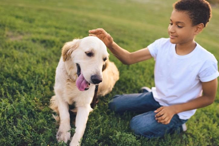 American teenager with dog Alzein Pediatrics