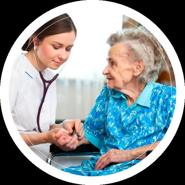 Caregiver taking blood pressure of old lady