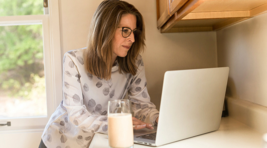 woman at computer on counter