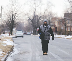 James Robertson of Detroit walks toward Woodward Avenue to catch his morning bus to Somerset Collection in Troy before walking to his job at Schain Mold & Engineering in Rochester Hills on Jan. 29.(RYAN GARZA/DETROIT FREE PRESS/TNS)