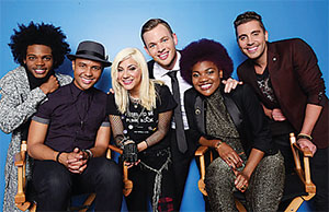 The top six are Quentin Alexander, Rayvon Owen, Jax, Clark Backham, Tyanna Jones and Nick Fradiani. Michael Becker is in the center.(COURTESY OF FOX BROADCASTING AMERICAN IDOL XIV:)