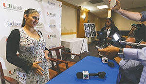 Yessica Flores, 38, talks to reporters after a press conference on Oct. 24 at Jackson Memorial Hospital's Ira Clark Diagnostic Treatment Center in Allapattah, Fla. Flores, who is pregnant, has tested positive for the Zika virus.(MATIAS J. OCNER/MIAMI HERALD/TNS)