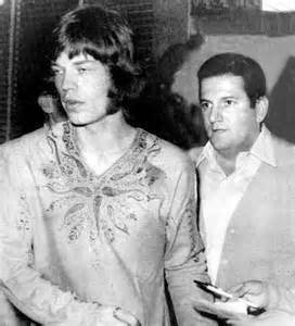 Mick Jagger with Allen Klein firmly on his tail