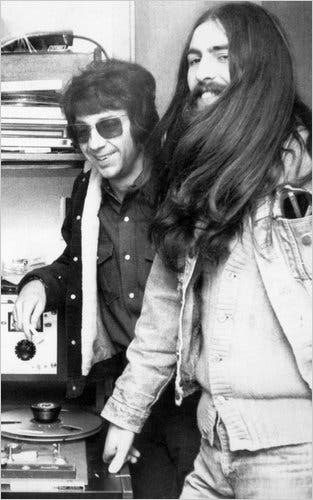 Phil Spector and George during the Let It Be sessions.