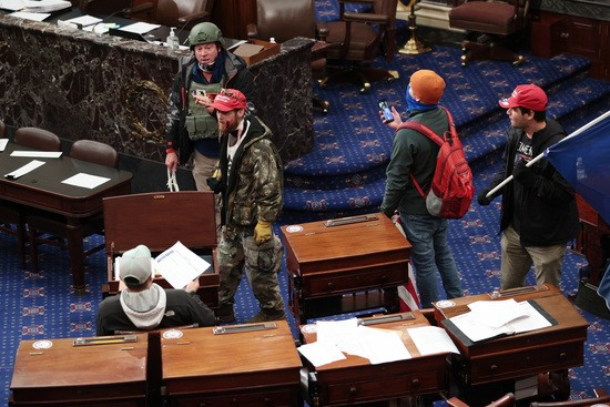 Extremists egged on by Trump breach the Capitol on Jan. 6.