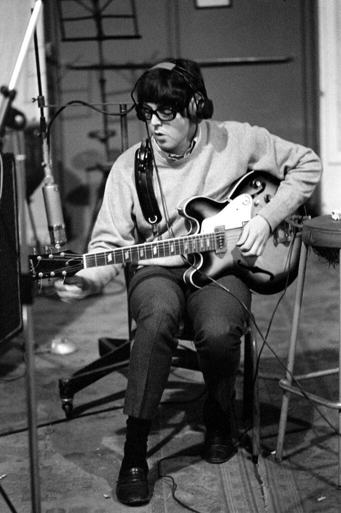 Paul McCartney on bass guitar.