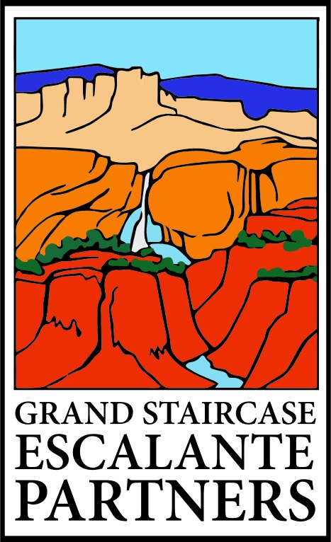 The Grand Staircase Escalante Partners Logo is an image of a river cutting through desert canyons.