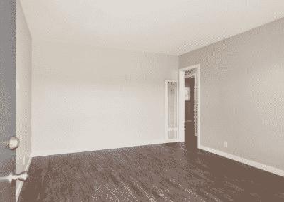Empty entryway with gray door and wood flooring