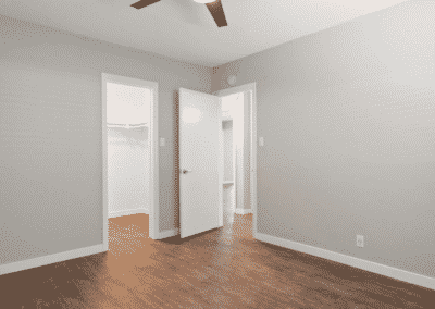 Empty bedroom with view of closets