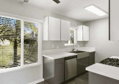 Kitchen with windows and white cabinets