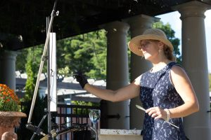 Janet Howard-Fatta painting at the Glemere a courtyard wedding