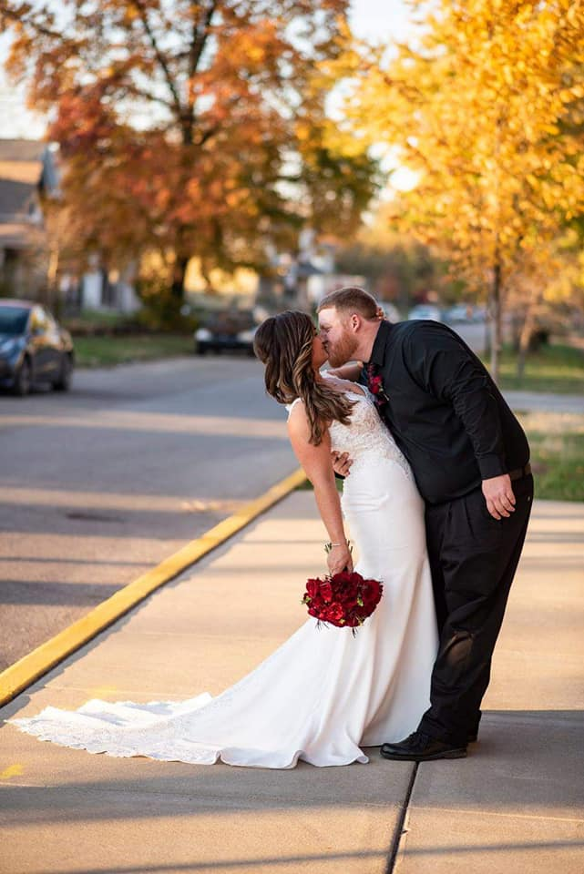 Bride and Groom Kissing on City sidewalk