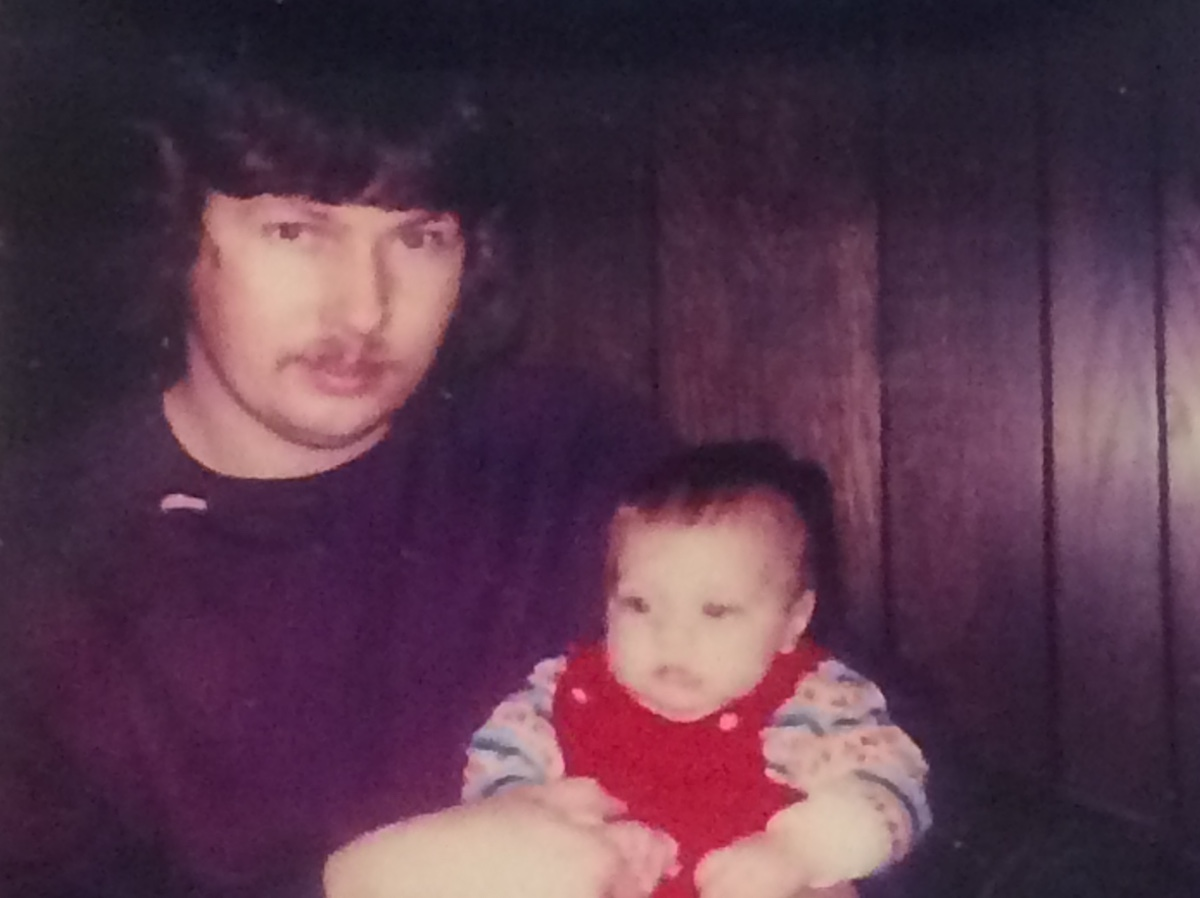 Photo of father and son as a baby