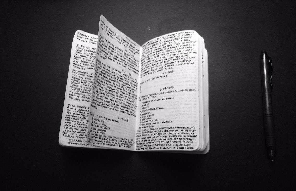 handwritten notes in a small journal