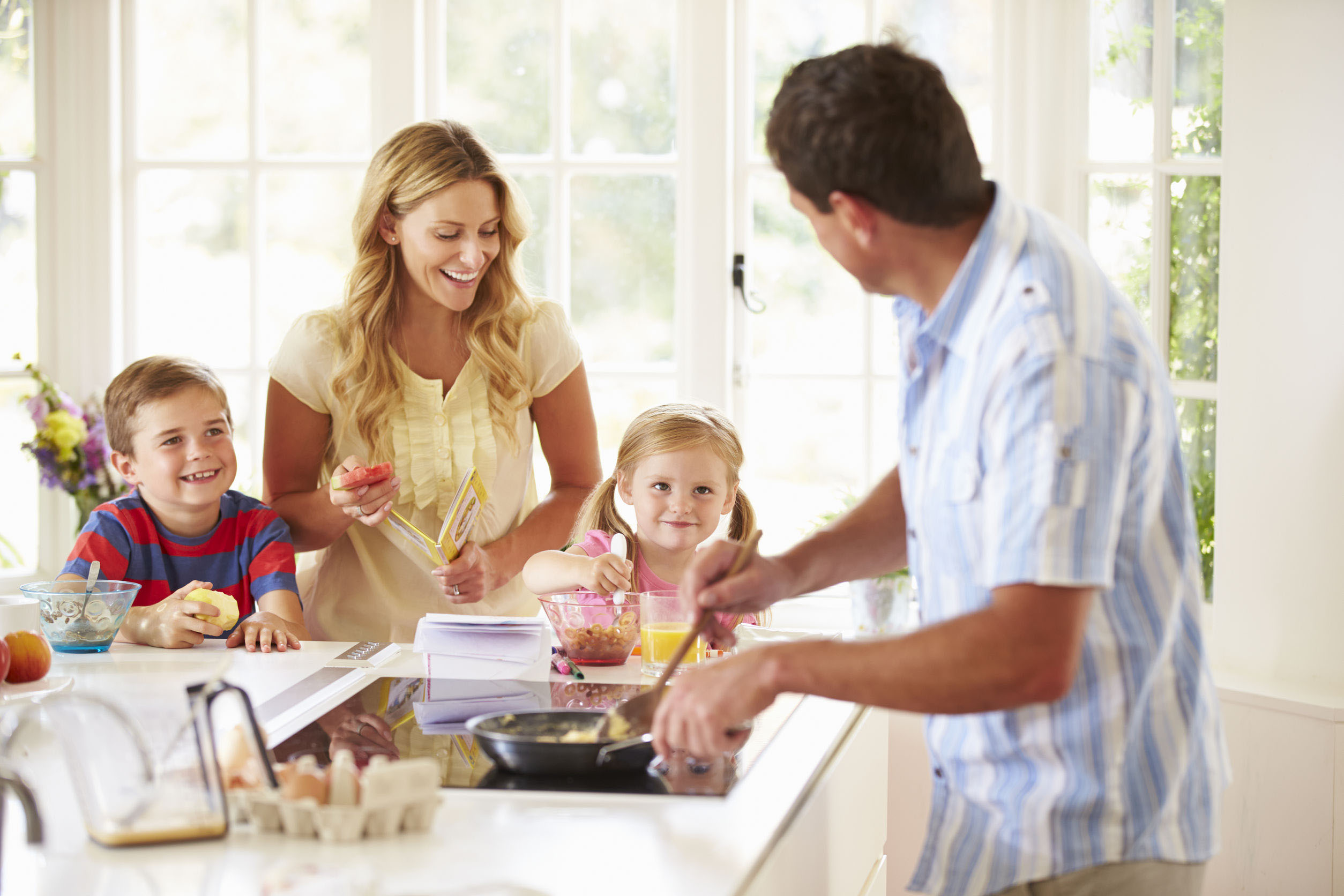photo of a family cooking breakfast in their home
