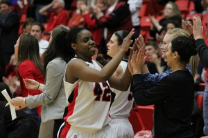 Former Youngstown State basketball forward Brandi Brown is congratulated by her teammates after a victory late in the 2012-13 season. Brown will travel to Sweden on Friday and play professional basketball with the Solna Vikings of the Damligan. Photo by Dustin Livesay/The Jambar