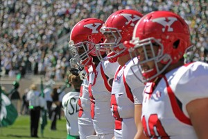 Youngstown State captains walk onto Spartan Stadium for the coin toss before kickoff of Saturday's matchup against Michigan State. The Penguins lost to the Spartans 55-17, dropping their record to 2-1. Photo by Dustin Livesay/The Jambar.