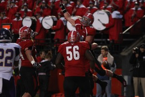 Youngstown State's Nate Adams (44) celebrates while being lifted in the air by Chris Elkins (66) after diving for a touchdown pass during the fourth quarter of Saturday nights matchup against Western Illinois University.  Photo by Dustin Livesay  |  The Jambar