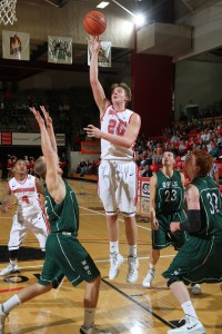 Sophomore Bobby Hain attempts a hook shot against Warren Wilson Thursday night at Beeghly Center. YSU routed the Owls, 104-58, in its home opener. Photo by Ron Stevens/ YSU Sports Information.