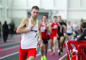Youngstown State University's Eric Rupe competes in the one mile run during Saturday's YSU National Invitational. Rupe won the event while teammate Austin McLean finished behind him.