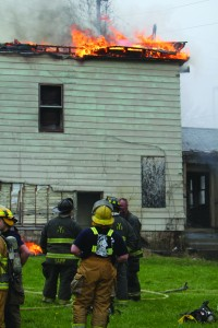 Cadets watch a controlled fire on Ford Street on Friday as part of an exercise run by the Youngstown Fire Department. The cadets are finishing their fire certification course and are looking to join local fire departments.