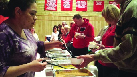 Volunteers from Youngstown SOUP's second event serve soup for audience members to sample and vote on, at the Calvin Center on April 27. Photo courtesy of Phil Kidd.