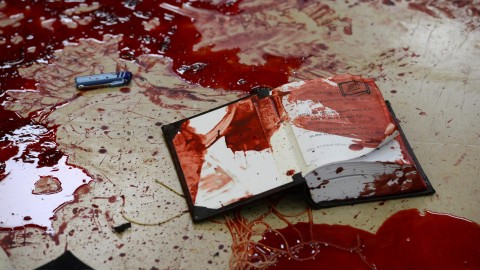Blood stains the floor of a synagogue where at least four Israelis were killed and eight injured by two Palestinians armed with a pistol, knives and axes. Suffering on both sides of the Israel-Palestine conflict is evidence of the violence spreading through the region.  (Kobi Gideon/Rex Features/Zuma Press/TNS)
