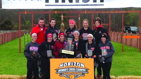The Youngstown State University women's cross country team poses for a picture after being named Horizon League Champions on Nov. 1. The Penguins have been named the conference champions in back-to-back season for the first time in program history. Photo courtesy of Sports information.