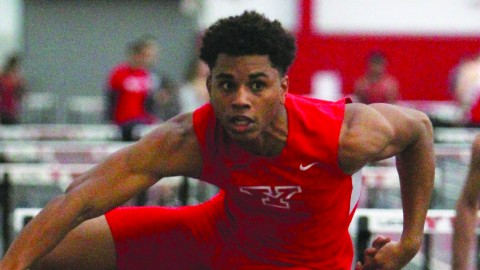 Freshman sprinter and hurdler Caleb Lloyd participates in the hurdles during the YSU Icebreaker before the winter break. Lloyd finished first in the 60-meter hurdles during the YSU Icebreaker. Courtesy of Sports Information. Photo courtesy of Sports Information.