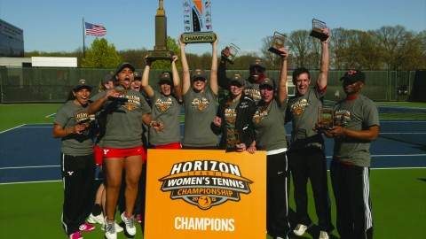 The Youngstown State University women's tennis team poses with the Horizon League championship trophy after winning the conference championship on April 26. The Penguins will travel to Los Angeles to play the University of Southern California in the first round of the NCAA tournament. Photo courtesy of YSU Sports Information.