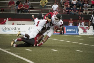 Corner D.J. Thomas and linebacker Lee Wright sack Zack Drayer (7) early in the first quarter of YSU's 48-3 win over St. Francis University.