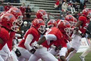 The Youngstown State University football team runs onto the field before the team's game against Missouri State University.