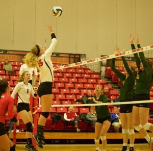 Lauren Thompson (15) tries to float the ball over the Wright State University front line.