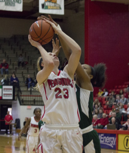 Youngstown State University forward Sarah Cash (23) gets blocked during the team's 53-43 loss to Cleveland State University.