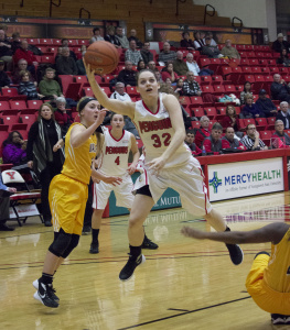 Youngstown State University guard Jenna Hirsch (32) gets fouled and makes the layup.