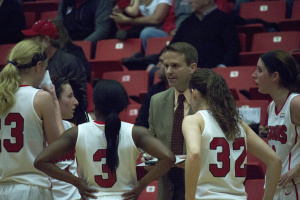 John Barnes, head coach of the Youngstown State University women's basketball team, draws up a play during a timeout.