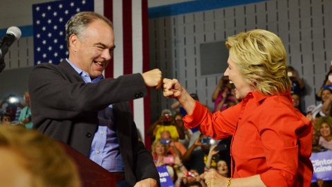 Democratic Party Presidential nominee Hillary Clinton and Vice Presidential nominee Tim Kaine bump fists upon arriving at Youngstown's East High School on Saturday. (Photo courtesy of Scott Williams)