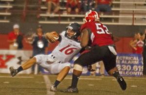 Youngstown State University's Savon Smith (52) sacks Robert Morris University quarterback Andrew Romanchak (16) in the third quarter of Saturday's game.