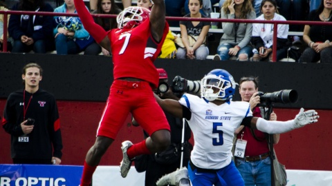 Kenny Bishop (7), defensive back for Youngstown State University, jumps in front of Clayton Smith (5), receiver for Indiana State University, to break up a pass down the field.