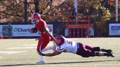 Youngstown State University running back Jody Webb breaks a tackle from Southern Illinois University's Chase Allen as he turns the corner.