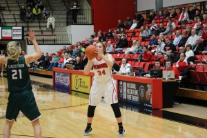Morgan Brunner (34) hits a 3 over the top of Jessica Lindstrom (21).